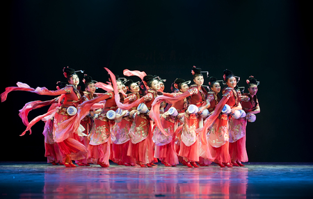 hoofer: CHENGDU - APR 11: Chengdu Art troupe perform national dance Calling for spring at sichuan song and dance theater in the new works for 2013 dance competition in Sichuan.Apr 11,2013 in Chengdu, China.