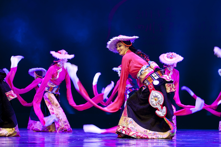 hoofer: CHENGDU - APR 12: Ganzi national song and dance troupe perform national dance merry songs and step dance at sichuan song and dance theater in the new works for 2013 dance competition in Sichuan.Apr 12,2013 in Chengdu, China.