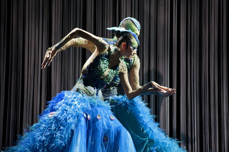 CHENGDU - SEP 23, 2012: chinese national dancers perform dance drama the peacock on stage at Jincheng theater.