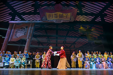 dance drama: CHENGDU - APR 10, 2013: Sichuan song and dance troupe perform the dance drama Sichuan Tea House at Jincheng theater. Editorial