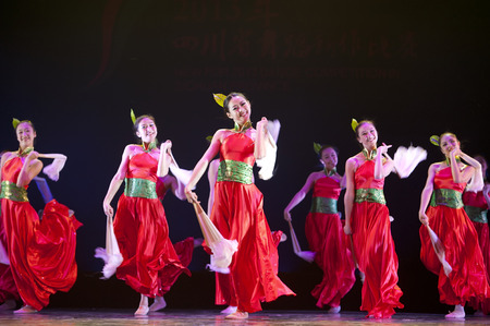 CHENGDU - APR 12, 2013: Art Institute of Sichuan University perform chinese national dance Flowers rhyme flow at sichuan song and dance theater in the new works for 2013 dance competition in Sichuan. Editorial