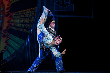 finery: CHENGDU - OCT 19, 2014: chinese traditional opera actress performs on stage at Sichuan opera theater.