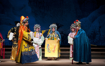 actors: CHENGDU - NOV 25, 2014: chinese traditional opera actors perform on stage at Jiaozi theater. Editorial