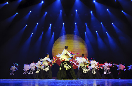 ardor: CHENGDU - SEP 26, 2010: chinese Yi ethnic dancers perform on stage at JIAOZI theater. Editorial
