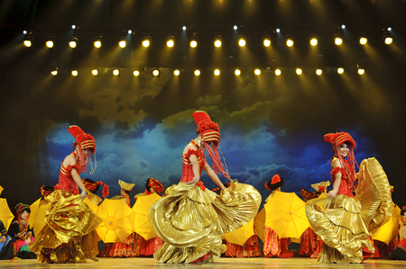 fervor: CHENGDU - SEP 26, 2010: chinese Yi ethnic dancers perform on stage at JIAOZI theater. Editorial