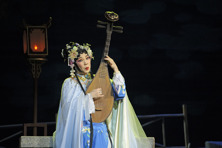 cantonese: CHENGDU - JUN 3, 2011: chinese Cantonese opera performer make a show on stage to compete for awards in 25th Chinese Drama Plum Blossom Award competition at Jinsha theater.
