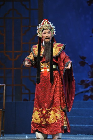 CHENGDU - JUN 7, 2011: Chinese Yue opera performer make a show on stage to compete for awards in 25th Chinese Drama Plum Blossom Award competition at Shengge theater. Editorial