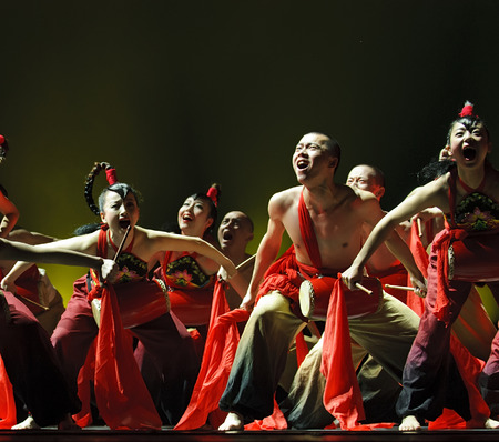 exaggerated: CHENGDU - DEC 10: chinese national dance performed by Shaanxi Song And Dance Troupe at JINCHENG theater.DEC 10,2007 in Chengdu, China.