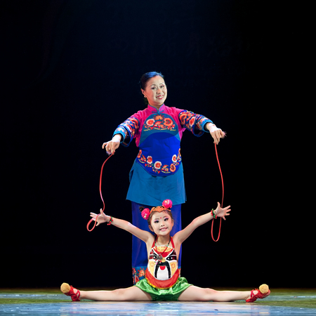 hoofer: CHENGDU - APR 12: Guangyuan Shudao Zhaohua art troupe perform chinese national dance Grandma and grandsons feelings at sichuan song and dance theater in the new works for 2013 dance competition in Sichuan.Apr 12,2013 in Chengdu, China. Editorial