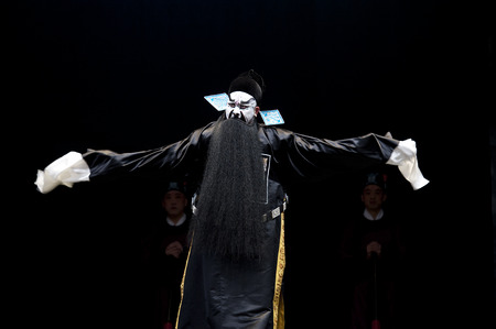 exaggerate: CHENGDU - FEB 14: chinese Sichuan traditional opera actor performs on stage at Sichuan opera theater.Feb 14, 2015 in Chengdu, China. Editorial