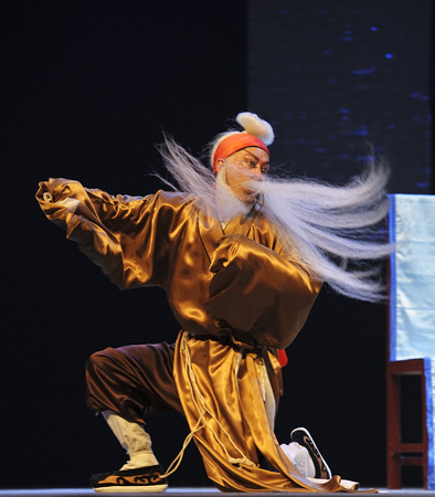 customary: CHENGDU - JUN 5: chinese Sichuan opera performer make a show on stage to compete for awards in 25th Chinese Drama Plum Blossom Award competition at Chongzhou theater.