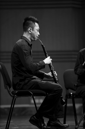 oboe: CHENGDU - JUN 20: musician performs English horn on wind music chamber music concert at odeum of Sichuan Conservatory of Music.