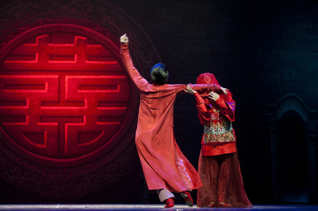 CHENGDU - NOV 27: chinese national dancers perform on stage at Jincheng theater.