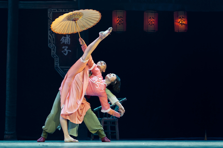 dance drama: CHENGDU - APR 10: Sichuan song and dance troupe perform the dance drama Sichuan Tea House at Jincheng theater .