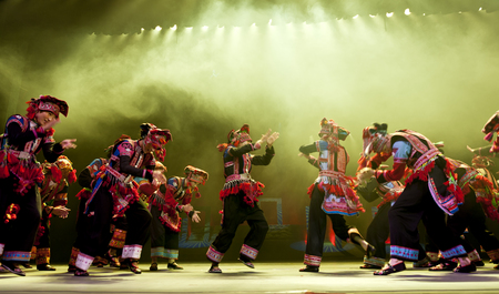 hoofer: CHENGDU - OCT 27: chinese national dancers perform traditional dance Dynamic Yunnan on stage at Jincheng theater. Editorial