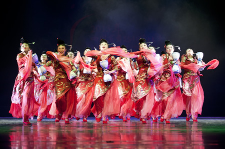 troupe: CHENGDU - APR 11: Chengdu Art troupe perform national dance Calling for spring at sichuan song and dance theater in the new works for 2013 dance competition in Sichuan.