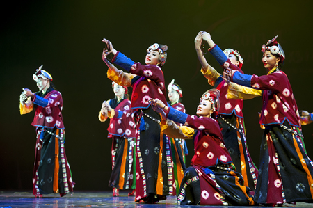 CHENGDU - APR 11: Ganzi national song and dance troupe perform tibetan national dance Prayer at sichuan song and dance theater in the new works for 2013 dance competition in Sichuan. Editorial