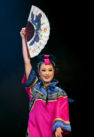 CHENGDU - APR 11: Deyang Song and Dance troupe perform chinese national dance Show New Year pictures at sichuan song and dance theater in the new works for 2013 dance competition in Sichuan. Editorial