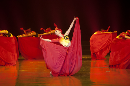 hoofer: CHENGDU - APR 13: Sichuan song and dance troupe perform chinese national dance Fire Beauty at sichuan song and dance theater in the new works for 2013 dance competition in Sichuan.
