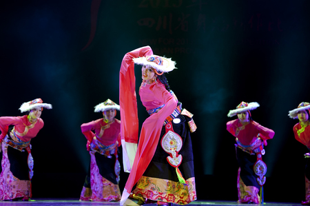 hoofer: CHENGDU - APR 12: Ganzi national song and dance troupe perform tibetan national dance merry songs and step dance at sichuan song and dance theater in the new works for 2013 dance competition in Sichuan.