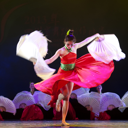 rhyme: CHENGDU - APR 12: Art Institute of Sichuan University perform chinese national dance Flowers rhyme flow at sichuan song and dance theater in the new works for 2013 dance competition in Sichuan.