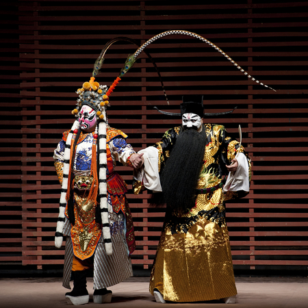 customary: CHENGDU - NOV 25: chinese traditional opera actors perform on stage at Jiaozi theater.