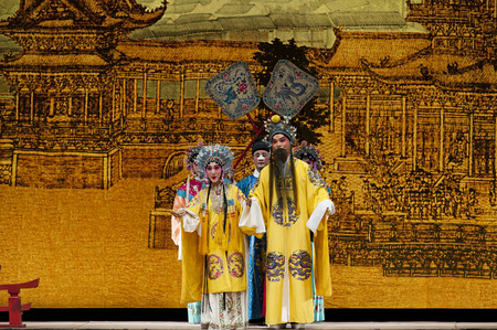 stage actors: CHENGDU - NOV 25: chinese traditional opera actors perform on stage at Jiaozi theater.