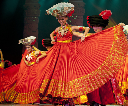 CHENGDU - SEP 26: chinese Yi ethnic dancers perform on stage at JIAOZI theater.