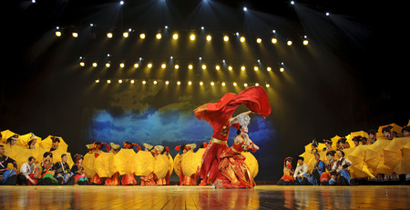sep: CHENGDU - SEP 26: chinese Yi ethnic dancers perform on stage at JIAOZI theater.