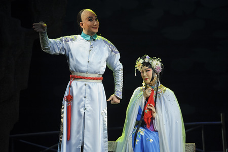 customary: CHENGDU - JUN 3: chinese Cantonese opera performer make a show on stage to compete for awards in 25th Chinese Drama Plum Blossom Award competition at Jinsha theater. Chinese Drama Plum Blossom Award is the highest theatrical award in China.