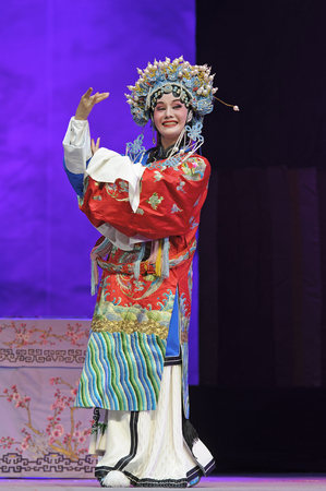 elegancy: CHENGDU - JUN 8: Chinese Chu opera performer make a show on stage to compete for awards in 25th Chinese Drama Plum Blossom Award competition at Experimental theater. Chinese Drama Plum Blossom Award is the highest theatrical award in China.