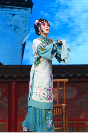 elegancy: CHENGDU - JUN 4: chinese Hui opera performer make a show on stage to compete for awards in 25th Chinese Drama Plum Blossom Award competition at Xinan theater. Chinese Drama Plum Blossom Award is the highest theatrical award in China.