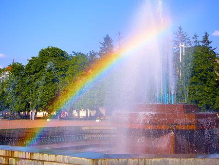A rainbow formed over the city fountain. Khmelnitsky, Ukraine
