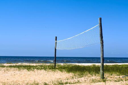 Volleyball net at the wild seashore Stock Photo
