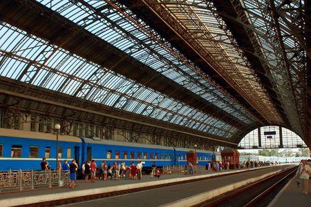railway transports: Arriving train at the railway station. Summer heat. Lviv, Ukraine
