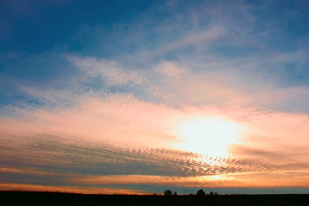 Sunset in the countryside. The sunlight makes its way through high stratospheric clouds Stock Photo - 8349482