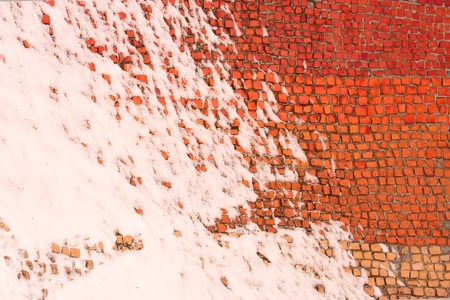 zoned: Old colored mosaics partially covered with snow Stock Photo