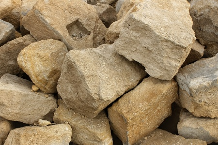 Heap big limestone. The stones used in construction Stock Photo
