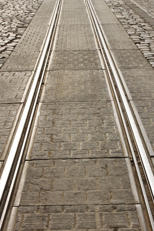 tramline: Detail of city tram track. Sunlight reflected on the rail Stock Photo