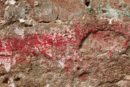 partially: The surface relief of concrete partially covered with colored paints