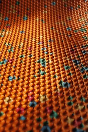 Play of light and shadow on a periodic structure with bases of multicolored rubber and metal needles. Used in medicine photo
