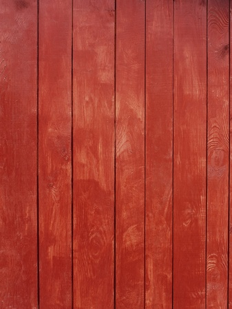 painted wood: Vertical parallel wooden planks, painted in red