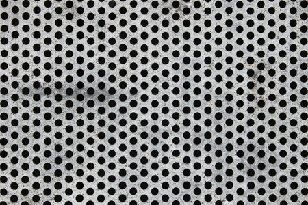 Old painted in white metal mesh with round holes of periodic structure Stock Photo - 9243160