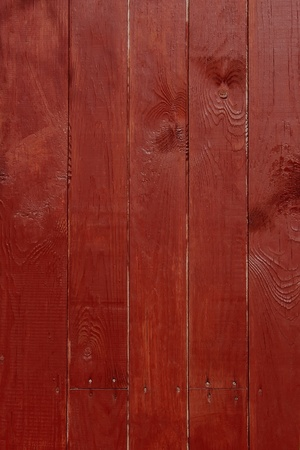 Parallel vertical wooden planks, painted in red photo