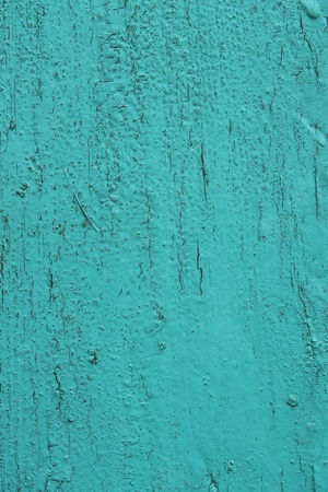Old wooden surface painted in bright aquamarine