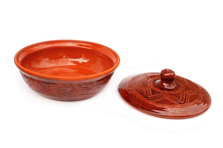 annealed: Annealed clay pot with a cover for cooking and prolonged storage of hot dishes. Isolated on white background Stock Photo