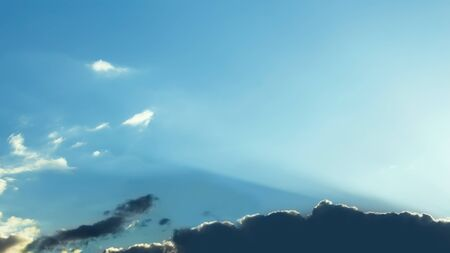 Cloudscape. The sun rays makes its way through clouds Stock Photo - 9527281