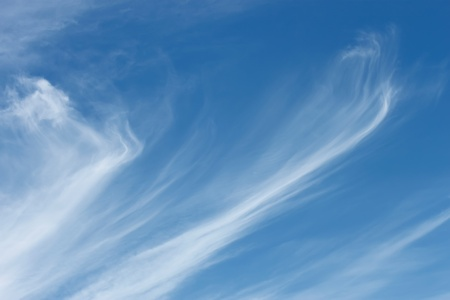 Stratospheric elongated clouds against blue sky