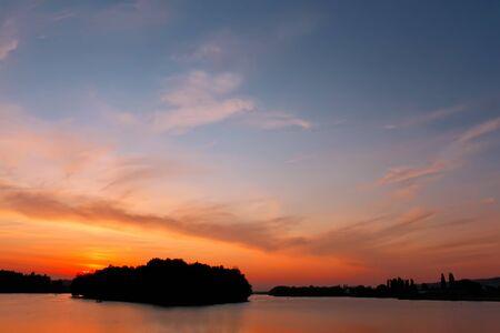 Multicolour cloudscape over reservoir at sunset, fine summer evening. Khmelnitsky, Ukraine Stock Photo - 10399257