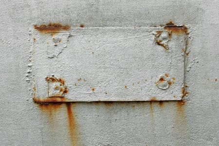 welded: Fragment of old metal surface with welded rectangular patch. Dyed in silver color Stock Photo